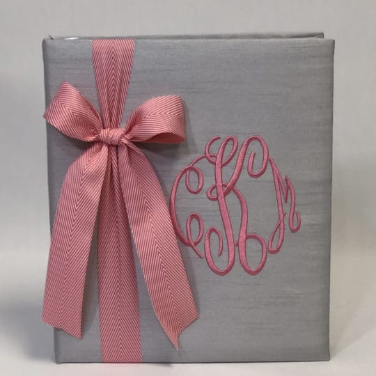 Shown in gray shantung with the pink bow and fancy monogram in matching thread.