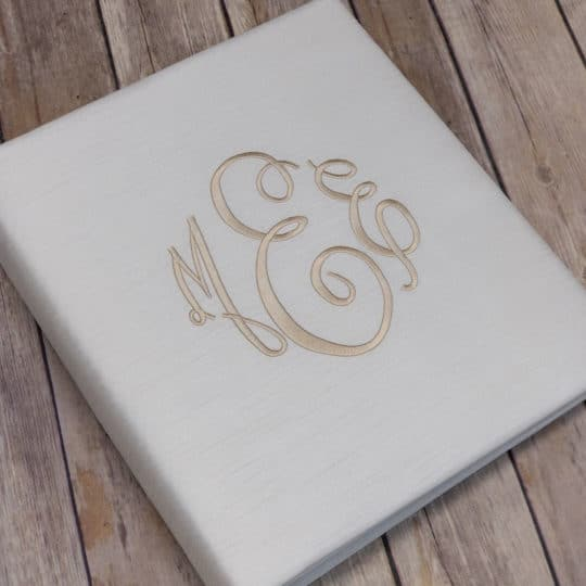 Shown in candlelight shantung with the fancy monogram in light beige thread.