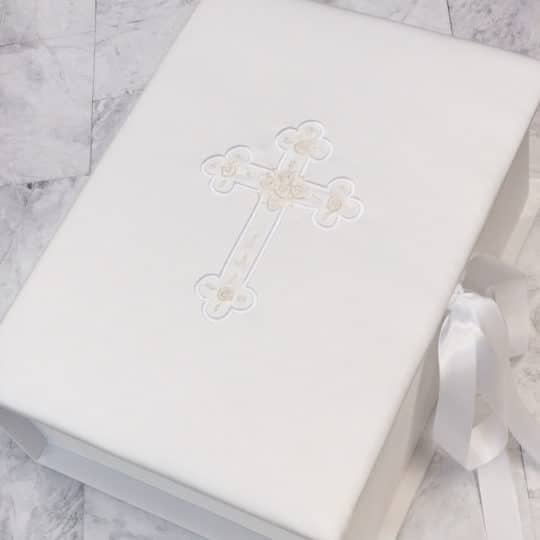 Shown in White Matte Satin with the Cross embroidered with rosettes.